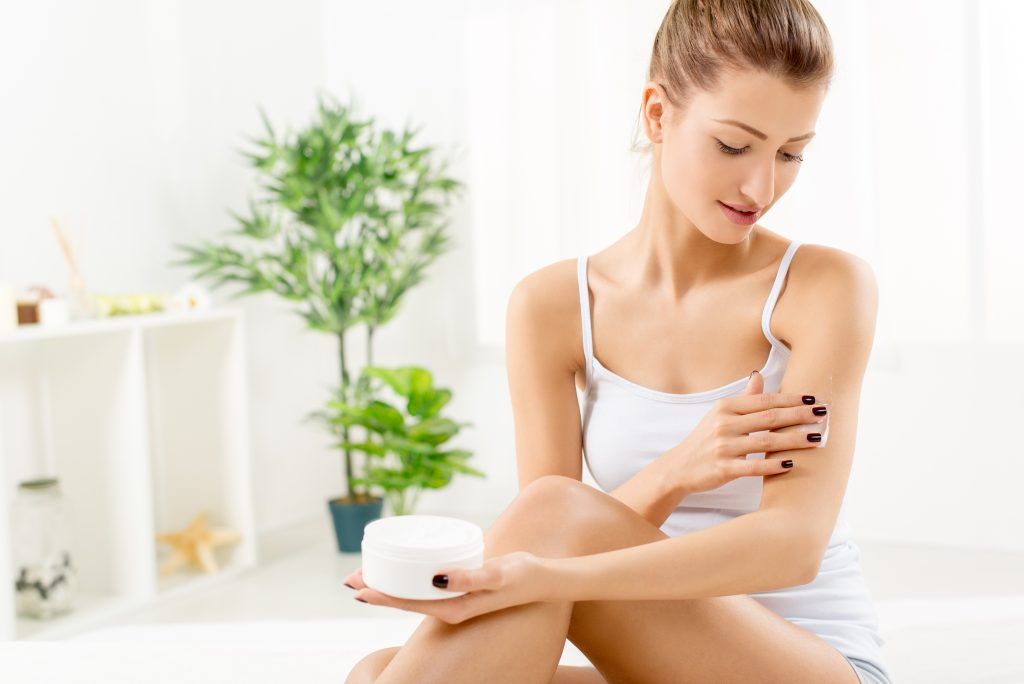 woman applying cannabis bod lotion