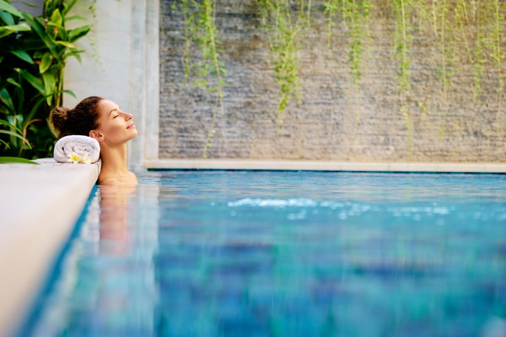 cannabis retreat relaxing in a swimming pool