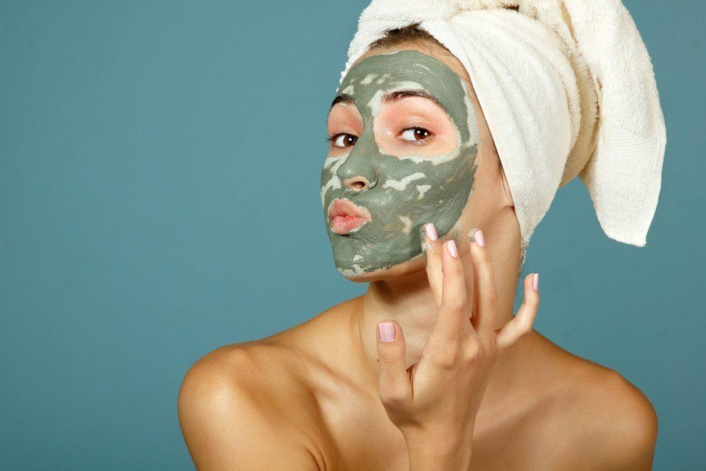 girl applying CBD infused face mask