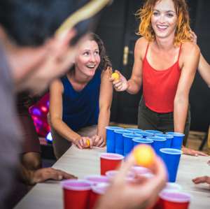 women playing bong pong at weed party