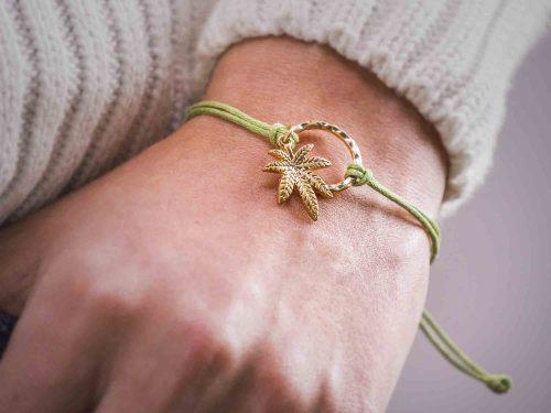 Lady model wearing weed leaf bracelet