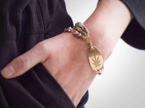 Model wearing Weed engraved gold plate bracelet