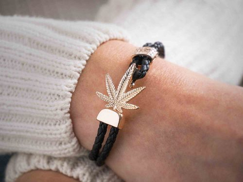 Model wears Black and rose gold marijuana bracelet