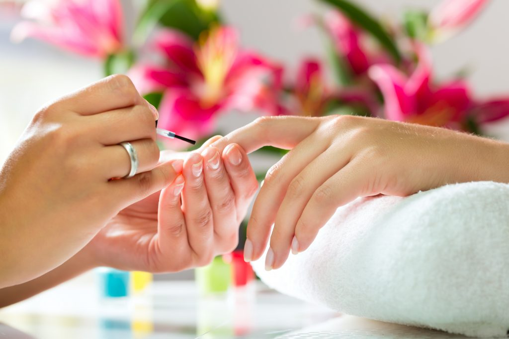 girl performing cannabis manicure