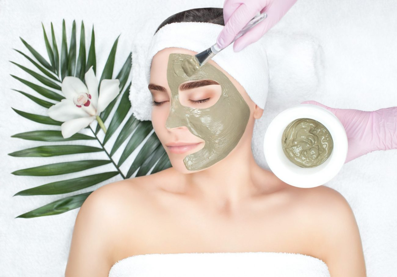 applying cbd mask to face for cbd facial