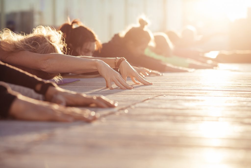 people practicing yoga with weed
